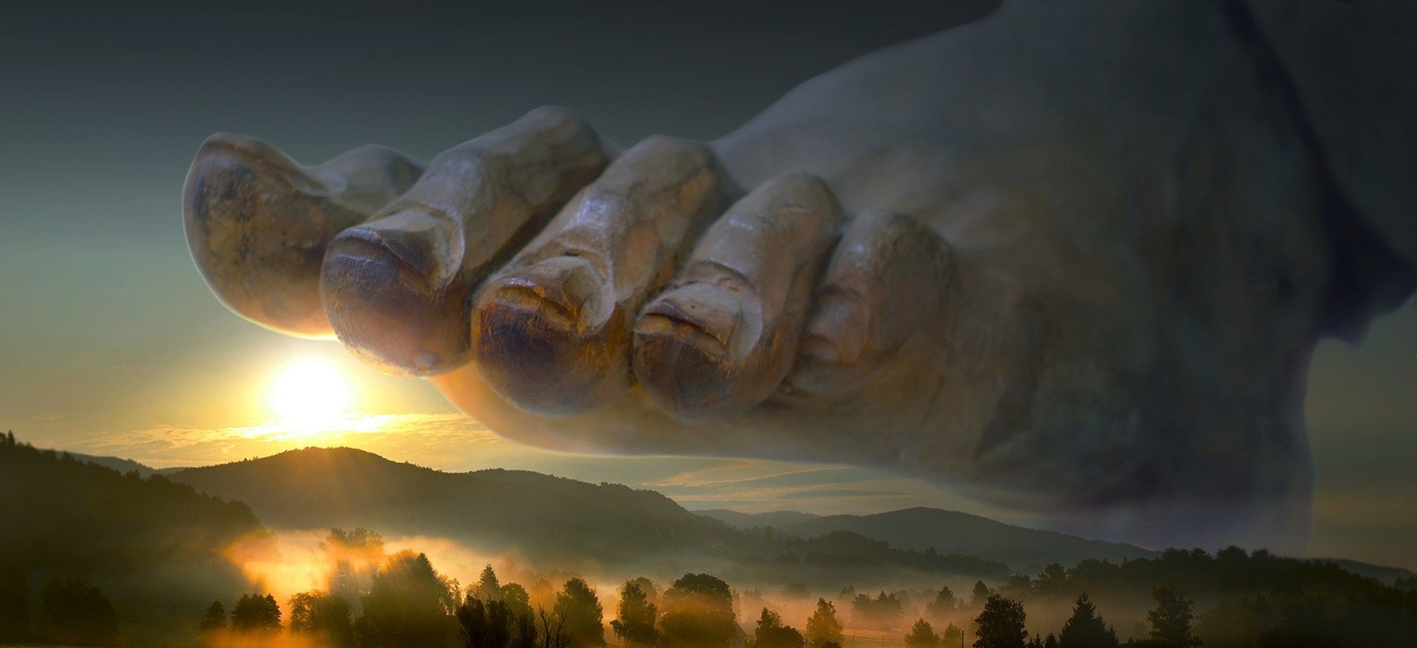 Poetry A giant foot stepping on a misted forested land with the sun hanging a little above the mountains