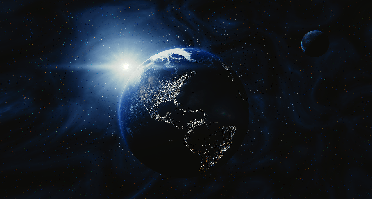 Poetry the earth lit up with all the lights of the continents against the dark space