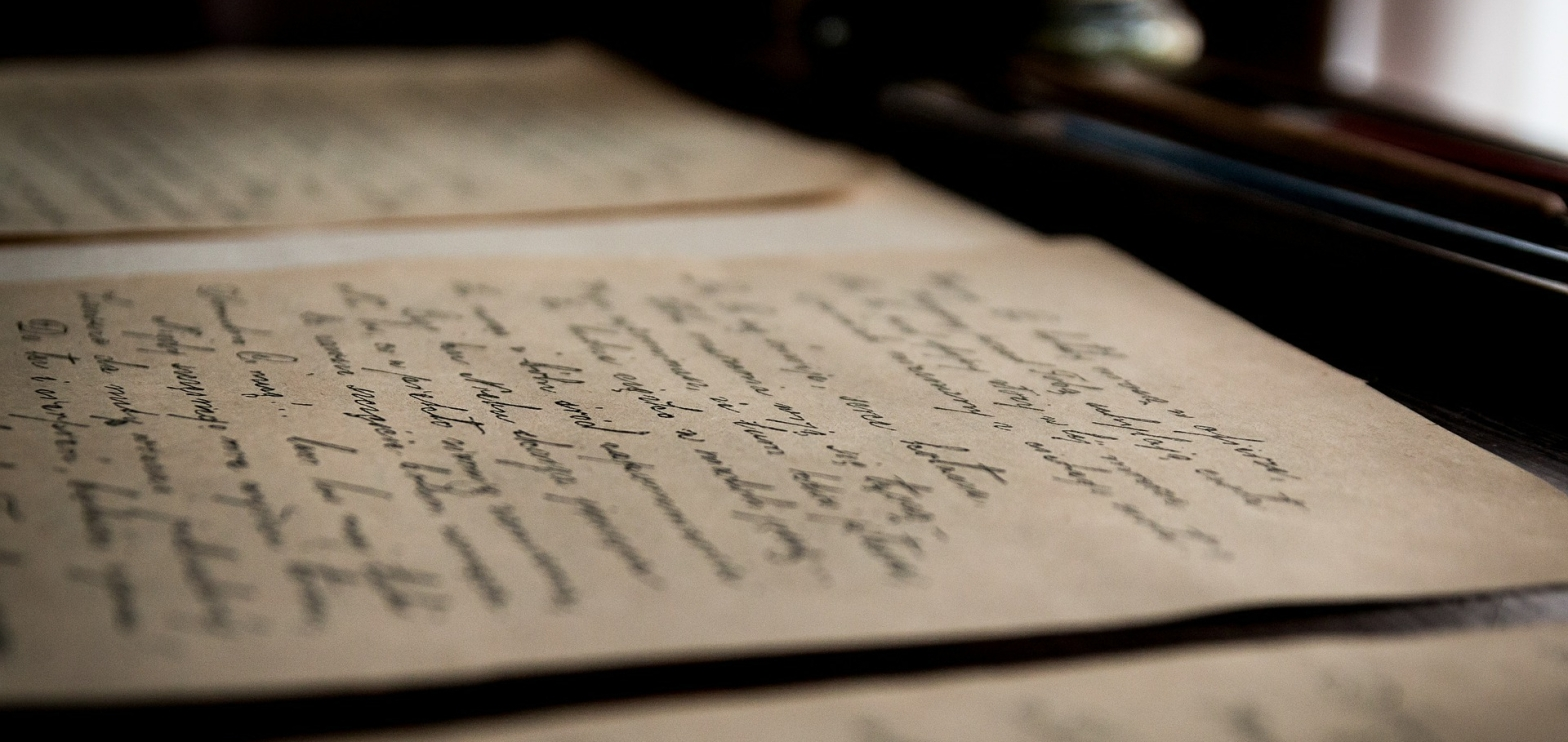 Poetry old stained papers inked in letters