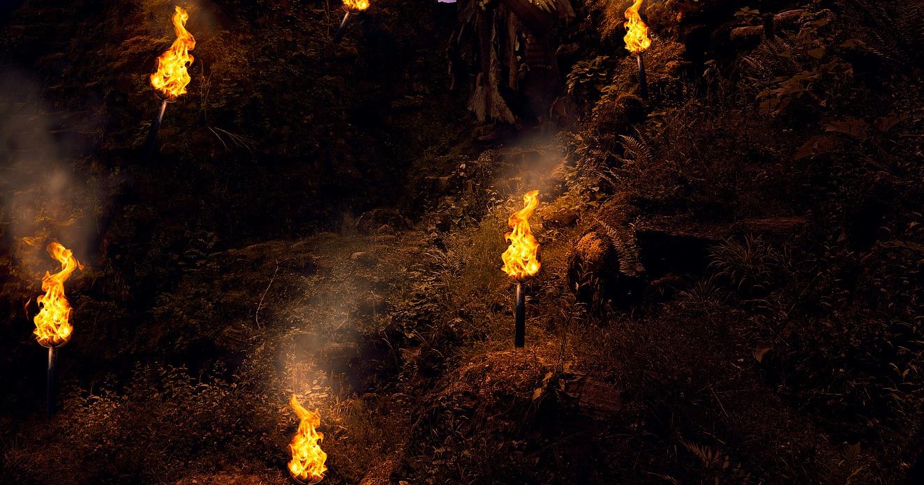 Poetry Flaming torches lighting up along the stone walls of a ruin