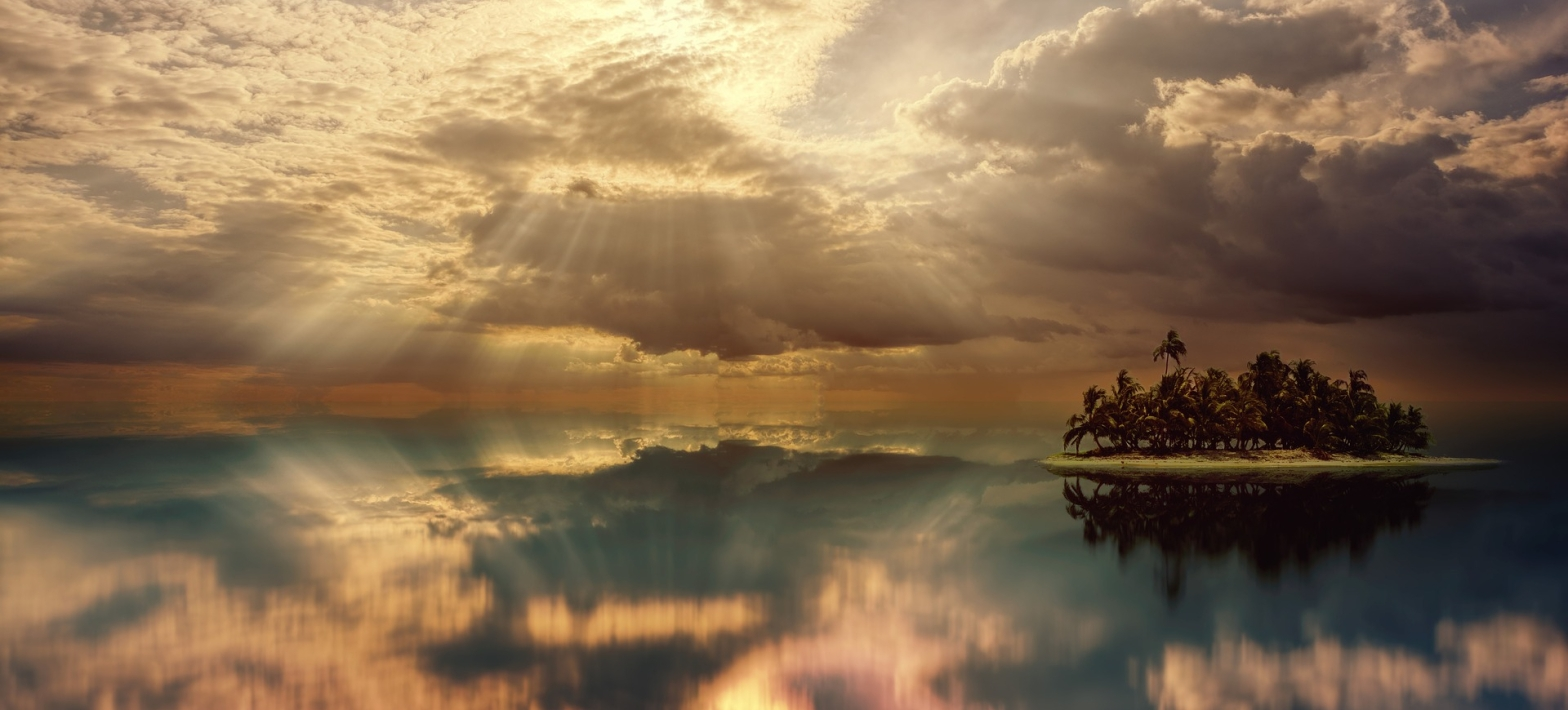 Poetry A small island on far right side in a backdrop of sky clouded with thick shafts of light streaming down and the waters reflecting the sky clear