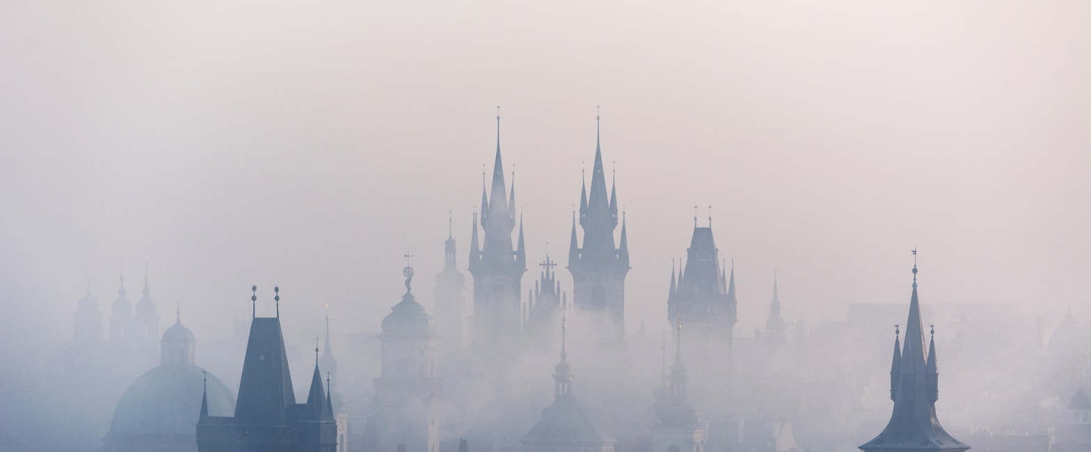 Poetry tall spires of buildings risings from thick mist of the past or future?
