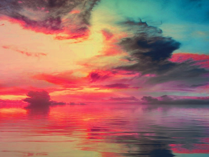 Poem sky colored in reds, yellows, blues reflected the same in an expanse of water
