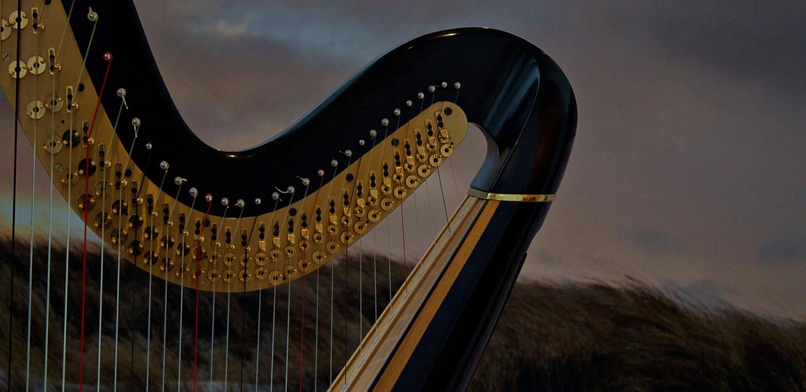 Poetry A harp against cloudy skies
