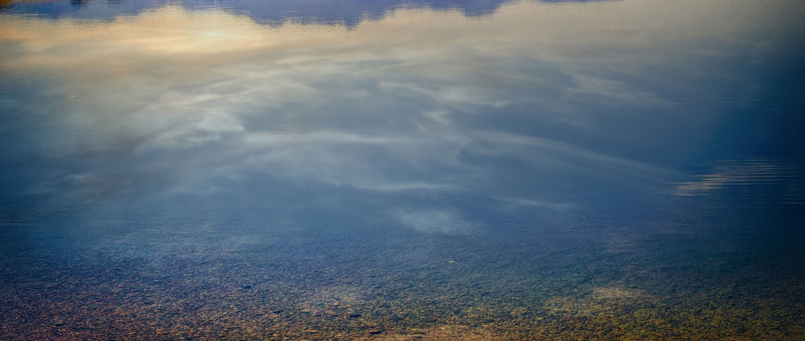 Poetry Reflection of the sky on a lake